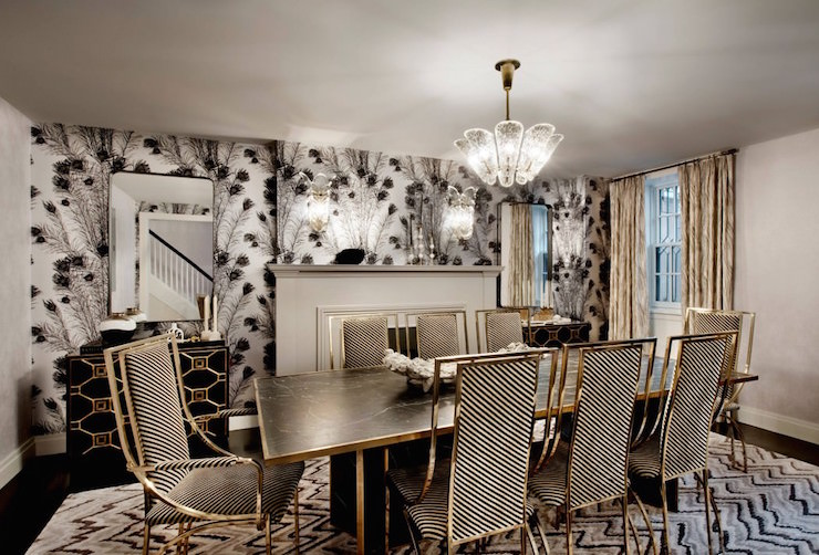 glam-hollywoodchic-dining-room-fireplace-peacock-feathers-wallcovering-black-and-white-chairs